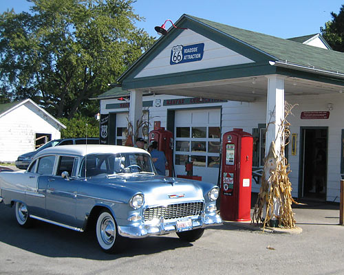 Vintage 1950s car parked at an old style filling station